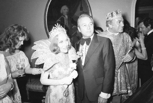 FILE - In this February 5, 1977 file photo, actress Gloria Swanson was crowned Queen of the Mardi Gras festivities by Louisiana Governor Edwin Edwards at a gala party in Beverly Hills, Calif. Louisiana's four-term former governor Edwards is having an ostentatious 90th birthday bash, Saturday, Aug. 12, 2017, with a $250-per-person price tag to attend. The powerful and charismatic Edwards was the dominant figure in Louisiana politics for decades before he went to federal prison for a corruption conviction. Out of prison for six years, he's got a wife five decades his junior, a 4-year-old son and continued popularity in his home state.