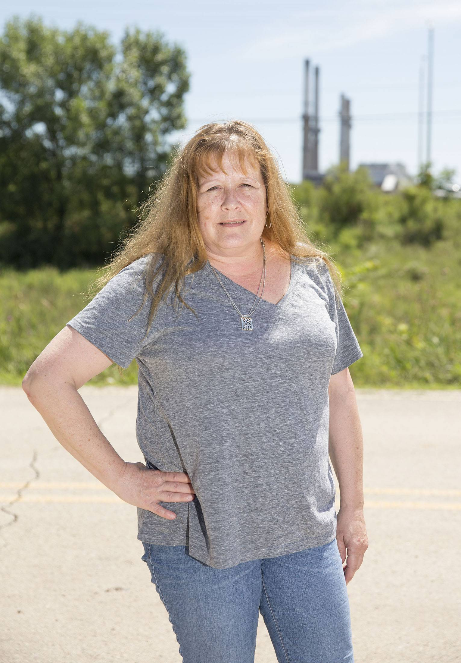 Lynnette Faje, a former employee of NRG Energy, near the NRG Energy, Inc. Will County Generating Station in Romeoville, Illinois, on July 26.