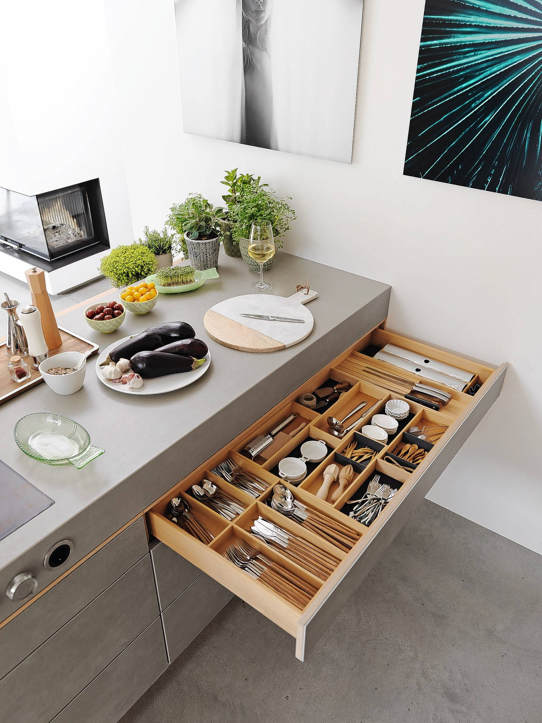 Kitchen drawer function is essential. This example offers a way to divide and organize a shallow drawer.
