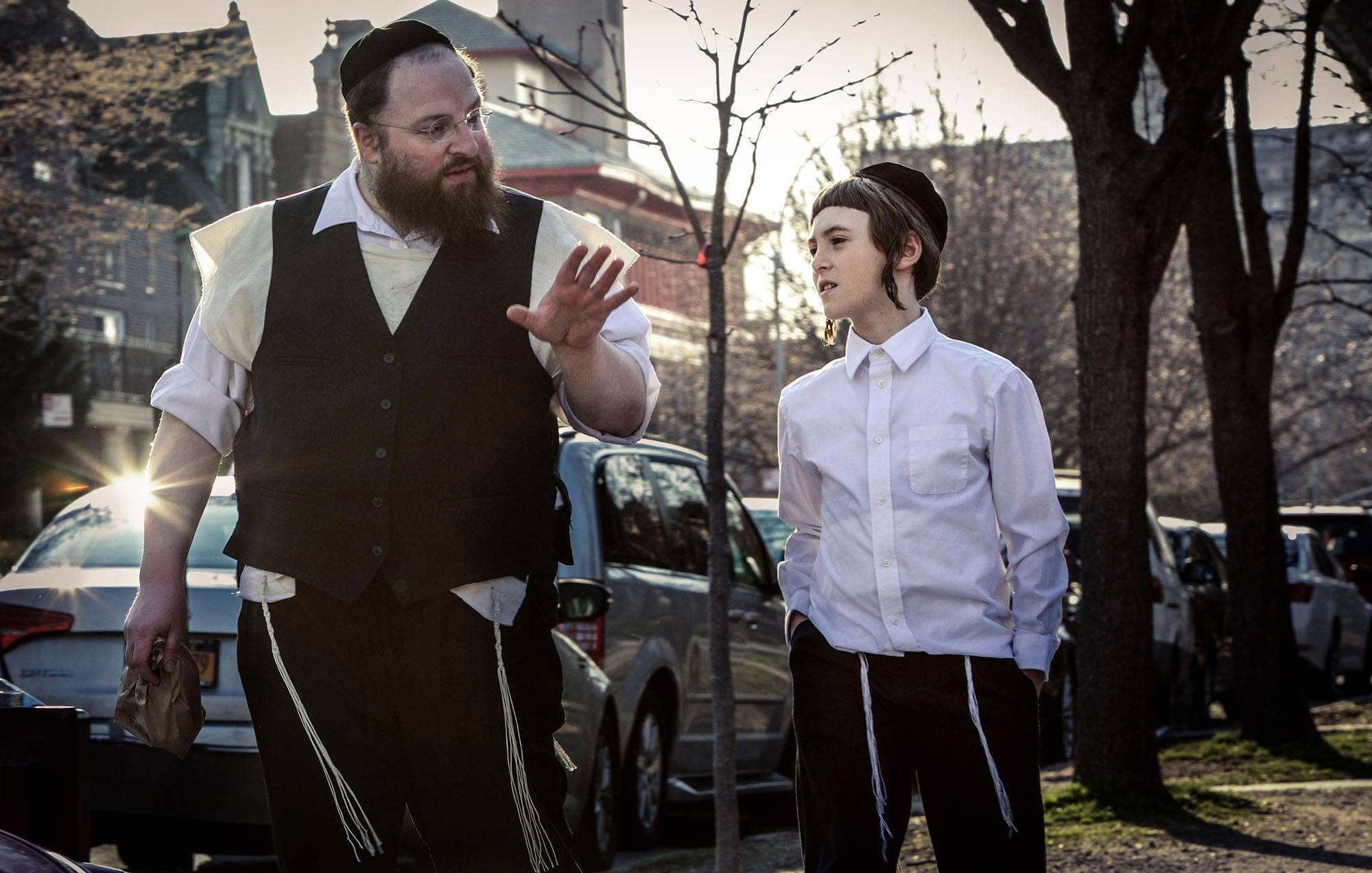 "A widower (Menashe Lustig) tries to take care of his son (Ruben Niborski) in Brooklyn's Hasidic community in ""Menashe."""