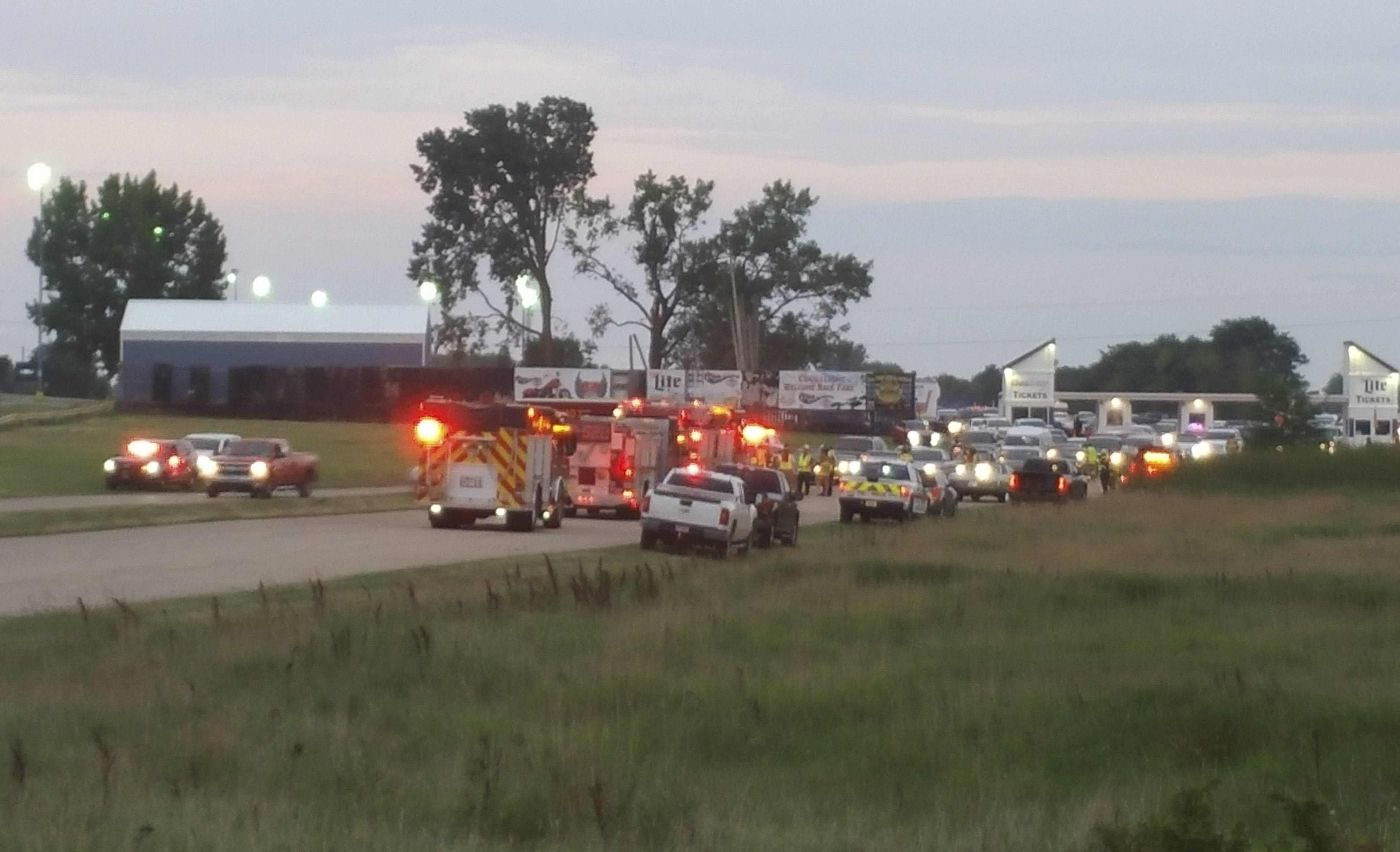 Emergency response vehicles gather at Great Lakes Dragaway on Sunday near Union Grove, Wisconsin. Three men were shot and killed during an auto racing event at the facility, a Wisconsin sheriff said. Kenosha County Sheriff David Beth said authorities responded around 7 p.m. after receiving reports about shots being fired. The three men were shot by another man at point-blank range near a food vendor, Beth said at a news conference Sunday night. No suspects were arrested and no one else was injured.
