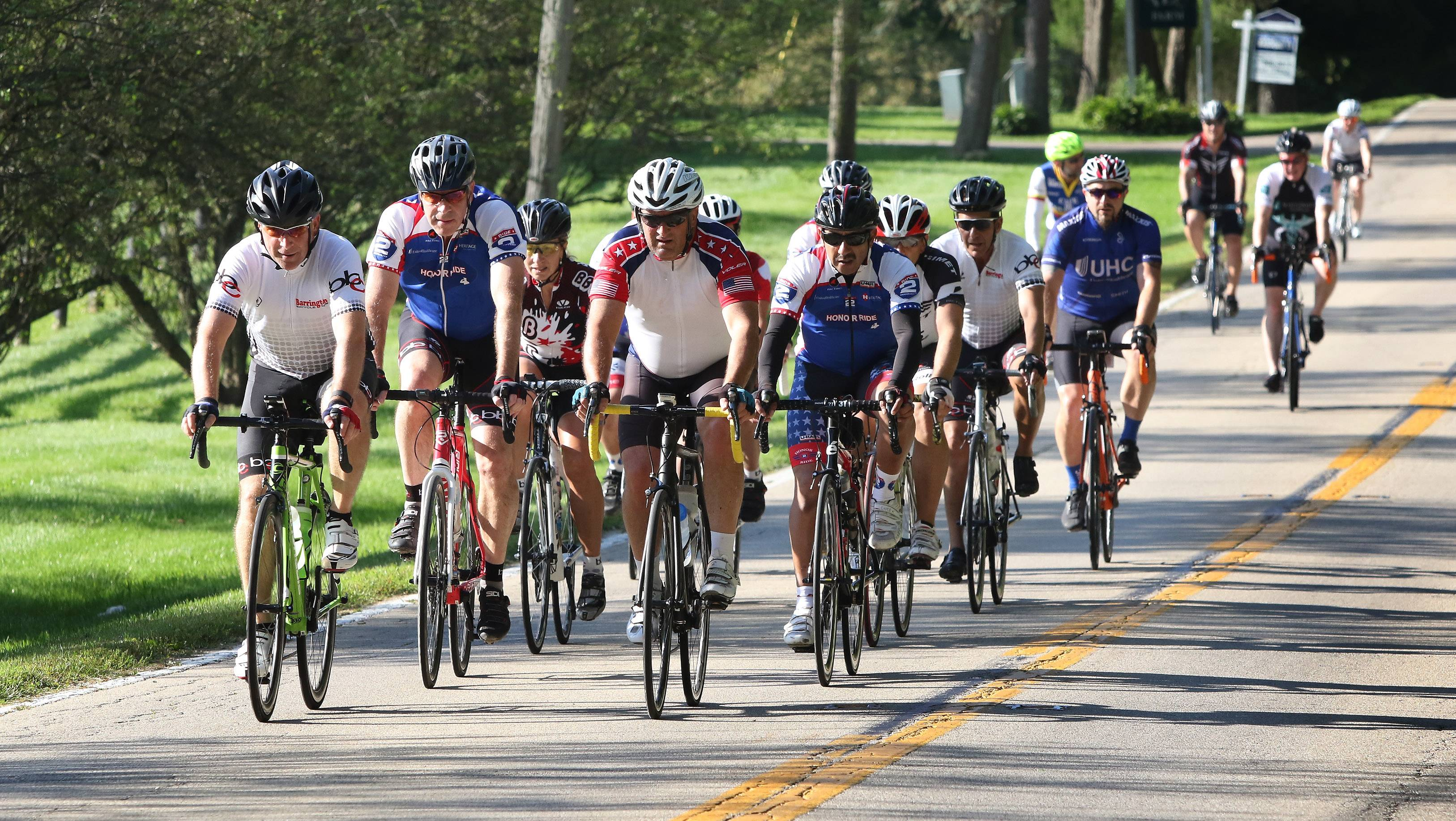 Cyclists make their way along Old Sutton Road during the 2017 Project Hero Barrington Honor Ride in Barrington Hills on Sunday. Hundreds of cyclists participated, including riders from the 500-mile UnitedHealthcare Great Lakes Challenge, raising money to help wounded veterans and first responders.