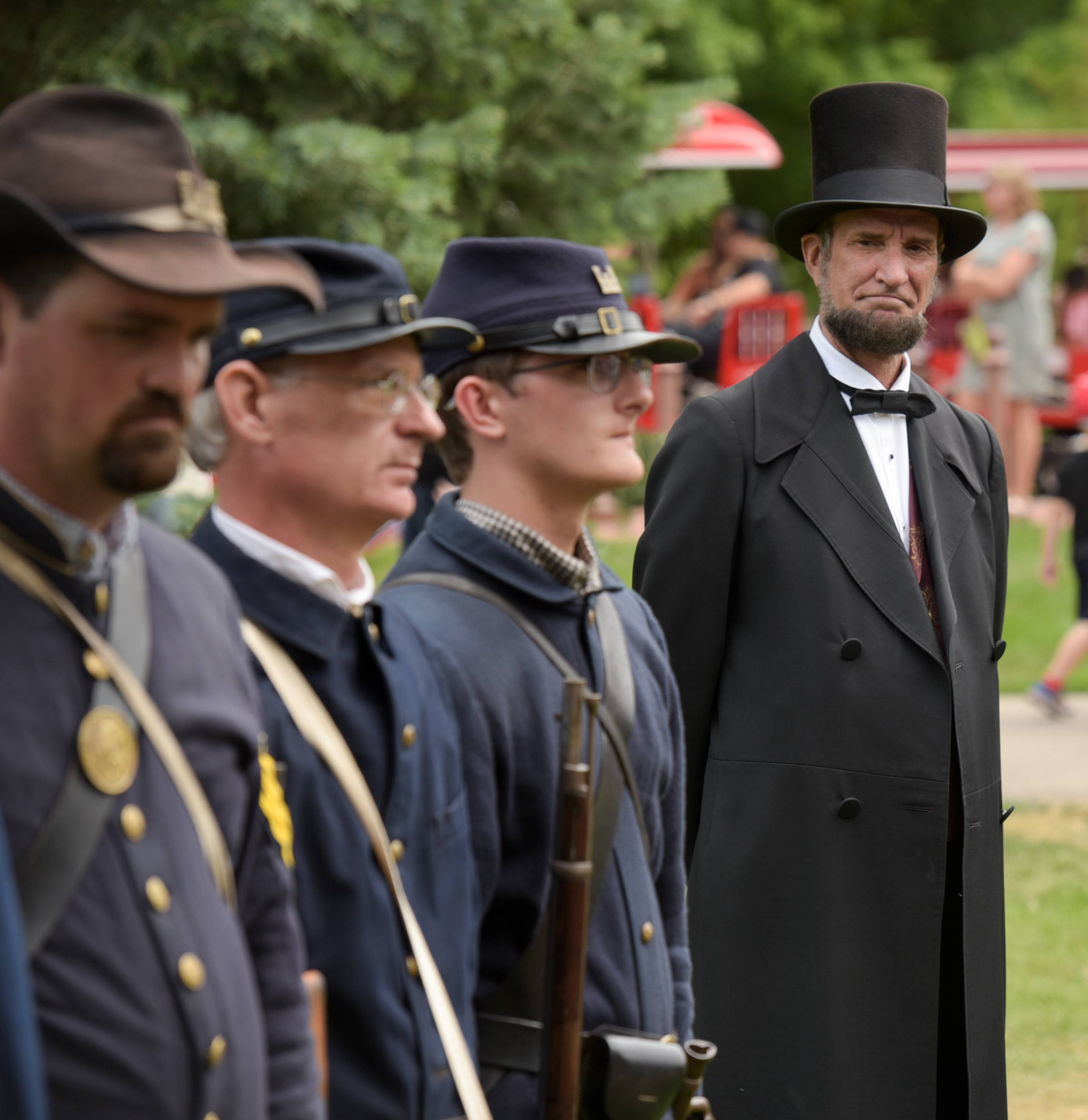President Abraham Lincoln, portrayed by Michael Krebs, inspects Union troops as they drill Sunday during Blackberry Farm's Civil War Days.