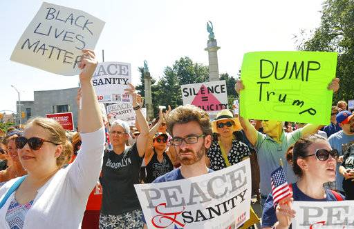 "Protesters listen during a ""Peace and Sanity"" rally Sunday Aug. 13, 2017, in New York, as speakers address white supremacy violence in Charlottesville, Va., yesterday."