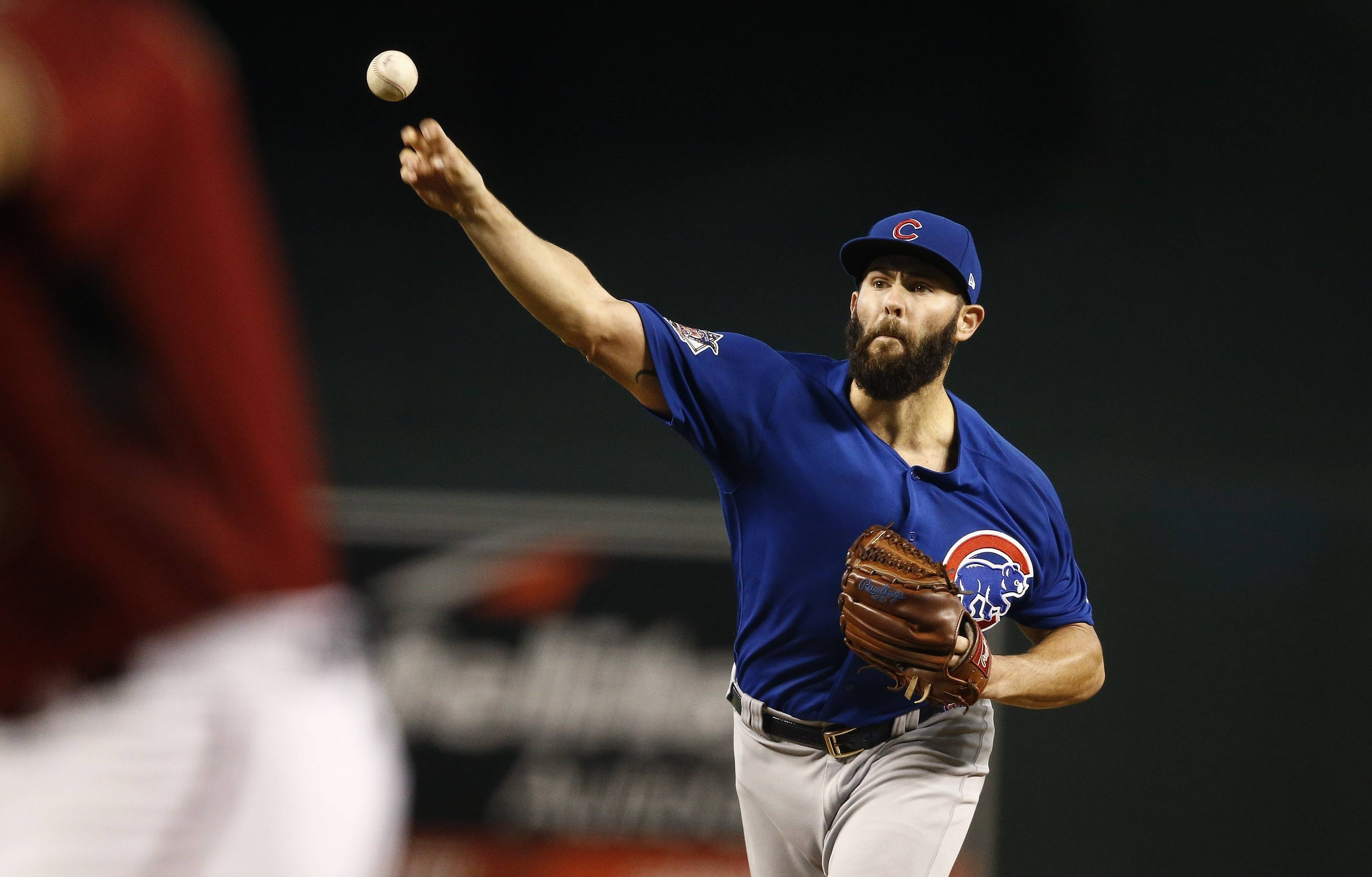 Chicago Cubs' Jake Arrieta, right, throws a pitch against Arizona Diamondbacks' David Peralta during the first inning of a baseball game Sunday, Aug 13, 2017, in Phoenix.