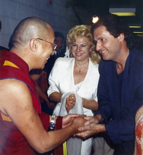 "FILE - In this October 1989 file photo, the Dalai Lama, left, talks to the comedy writing and acting team of Renee Taylor and Joe Bologna, during a backstage visit prior to the Dalai Lama's convocation on the subject of compassion at UC Irvine in Irvine, Calif. The Dalai Lama gave a special marriage blessing in the Tibetan Buddhist rite to Taylor and Bologna. Oscar-nominated writer Bologna has died. He was 82. His manager Matt Sherman says Bologna died Sunday, Aug. 13, 2017, after a three-year battle against pancreatic cancer. Taylor credited his doctors for prolonging his life so he could receive a lifetime achievement award at the Night of 100 Stars on Feb. 26. Bologna was nominated for an Oscar in 1971 for best adapted screenplay for ""Lovers and Strangers.� He won an Emmy in 1973. (AP Photo/File)"