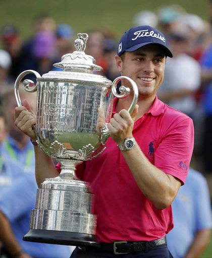 Justin Thomas poses with the Wanamaker Trophy after winning the PGA Championship golf tournament at the Quail Hollow Club Sunday, Aug. 13, 2017, in Charlotte, N.C. (AP Photo/Chris O'Meara)