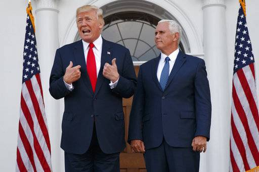 "In this Aug. 10, 2017, photo, President Donald Trump, accompanied by Vice President Mike Pence, speaks to reporters before a security briefing at Trump National Golf Club in Bedminster, N.J. Pence departs Sunday for Latin America, a trip that comes on the heels of yet another provocative statement fromTrump that Pence is sure to have to answer for: this time Trump's sudden declaration that he would not rule out a ""military option� in Venezuela, where president Nicolas Maduro has been consolidating power, plunging the country into chaos. (AP Photo/Evan Vucci)"