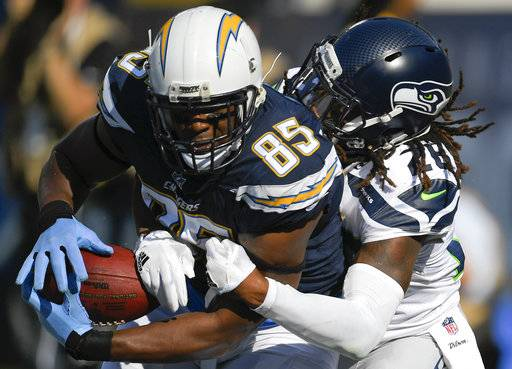 Los Angeles Chargers tight end Antonio Gates (85) hauls in a touchdown pass as Seattle Seahawks defensive back Shaquill Griffin (26) defends during the first half of an NFL football game Sunday, Aug. 13, 2017, in Carson, Calif. (AP Photo/Mark J. Terrill)