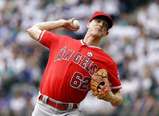 Los Angeles Angels starting pitcher Parker Bridwell throws against the Seattle Mariners in the first inning of a baseball game, Sunday, Aug. 13, 2017, in Seattle. (AP Photo/Elaine Thompson)