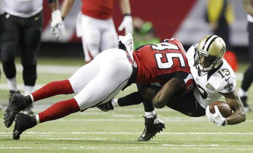 FILE - In this Jan. 1, 2017, file photo, Atlanta Falcons middle linebacker Deion Jones (45) hits New Orleans Saints wide receiver Michael Thomas (13) during the first half of an NFL football game in Atlanta. Falcons head coach Dan Quinn says Jones is a natural playmaker who can help team get back to the Super Bowl for a second straight season. (AP Photo/David Goldman, File)