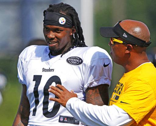 Pittsburgh Steelers wide receiver Martinis Bryant (10) is instructed by receiver coach Hines Ward during a practice at the NFL football team's training camp in Latrobe, Pa., Sunday, Aug. 13, 2017. It was Bryant's first day back at practice with the team after serving a year-long suspension. (AP Photo/Gene J. Puskar)