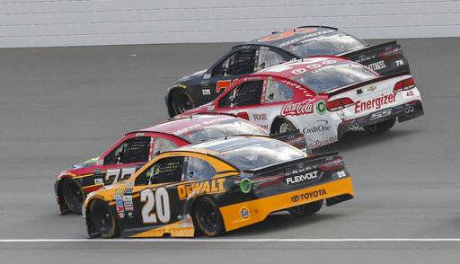 Matt Kenseth (20); Erik Jones (77); Kyle Larson (42) and Martin Truex Jr. (78) head into turn one on the last restart of the NASCAR Cup Series auto race in Brooklyn, Mich., Sunday, Aug. 13, 2017. Larson won the race. (AP Photo/Paul Sancya)
