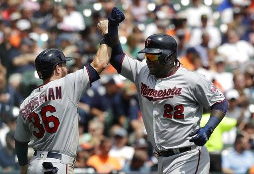 Minnesota Twins designated hitter Miguel Sano (22) is greeted at home plate by Robbie Grossman after they both scored on Sano's two-run home run during the third inning of a baseball game against the Detroit Tigers, Sunday, Aug. 13, 2017, in Detroit. (AP Photo/Carlos Osorio)