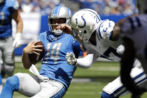 Detroit Lions quarterback Jake Rudock (14) slides in front of Indianapolis Colts cornerback Nate Hairston (27) during the first half of an NFL preseason football game, Sunday, Aug. 13, 2017, in Indianapolis. (AP Photo/Darron Cummings)
