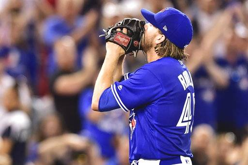 Toronto Blue Jays starting pitcher Chris Rowley reacts after being pulled from the game, having given up a single run, during sixth inning AL MLB baseball action, in Toronto on Saturday, Aug. 12, 2017. (Frank Gunn/The Canadian Press via AP)