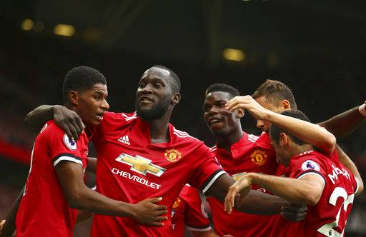 Manchester United's Romelu Lukaku, second left, celebrates scoring his side's first goal of the game during the English Premier League soccer match between Manchester United and West Ham United at Old Trafford in Manchester, England, Sunday, Aug. 13, 2017. (AP Photo/Dave Thompson)