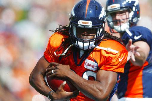 File- This July 31, 2017, file photo shows Denver Broncos running back Jamaal Charles running with a hand off from quarterback Paxton Lynch during drills at an NFL football training camp in Englewood, Colo. The Denver Broncos will soon discover if Charles is still Jamaal Charles. Coach Vance Joseph says he'll take the bubble wrap off the veteran running back sometime this preseason but he isn't sure if that will be against the 49ers, Packers or Cardinals. (AP Photo/David Zalubowski, File)