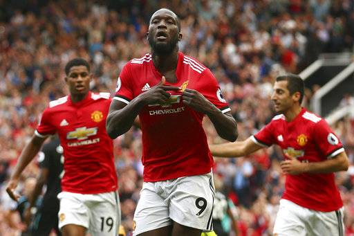 Manchester United's Romelu Lukaku celebrates scoring his side's first goal of the game during the English Premier League soccer match between Manchester United and West Ham United at Old Trafford in Manchester, England, Sunday, Aug. 13, 2017. (AP Photo/Dave Thompson)
