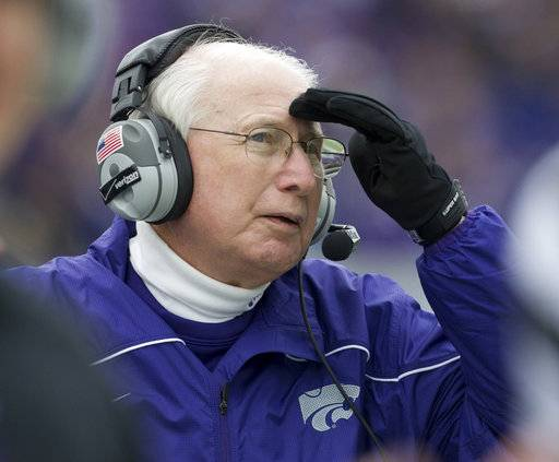 FILE - In this Oct. 6, 2012, file photo, Kansas State coach Bill Snyder watches a replay on the scoreboard during the second half of an NCAA college football game against Kansas, in Manhattan, Kan. Kansas State coach Bill Snyder is back for another season, despite a cancer scare earlier this year. The 77-year-old coach believes he has a team capable of contending for a Big 12 title and even a national championship, and no amount of chemotherapy was going to keep him from leading the Wildcats for the 26th year. (AP Photo/Orlin Wagner, File)