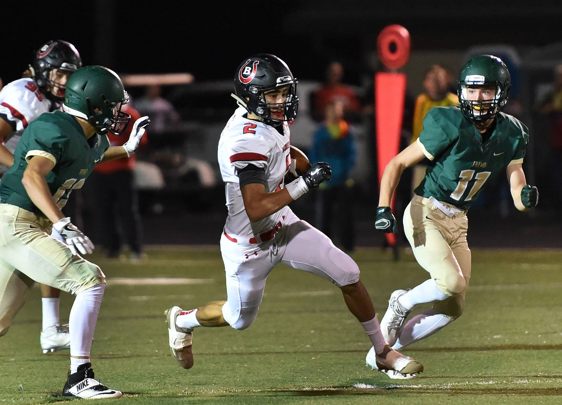 Luis Cossio, here eluding Fremd tacklers last season, figures to be part of a speedy receiving corps at Barrington this fall.
