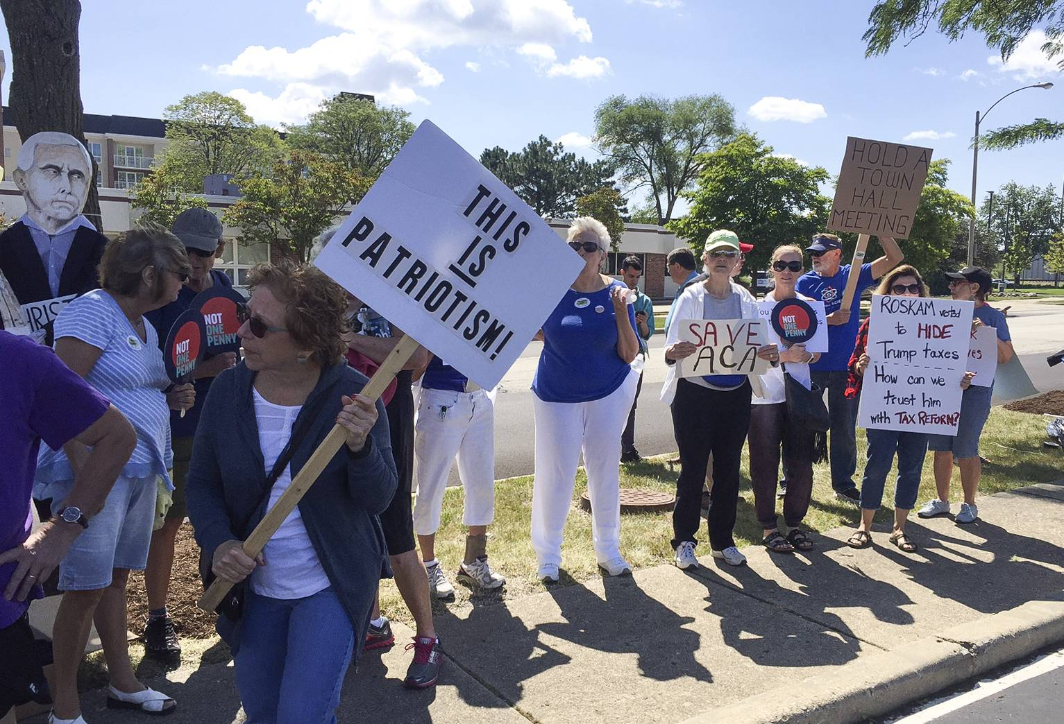 Protesters march at an appearance Wednesday by U.S. Rep. Peter Roskam Wednesday in Palatine.