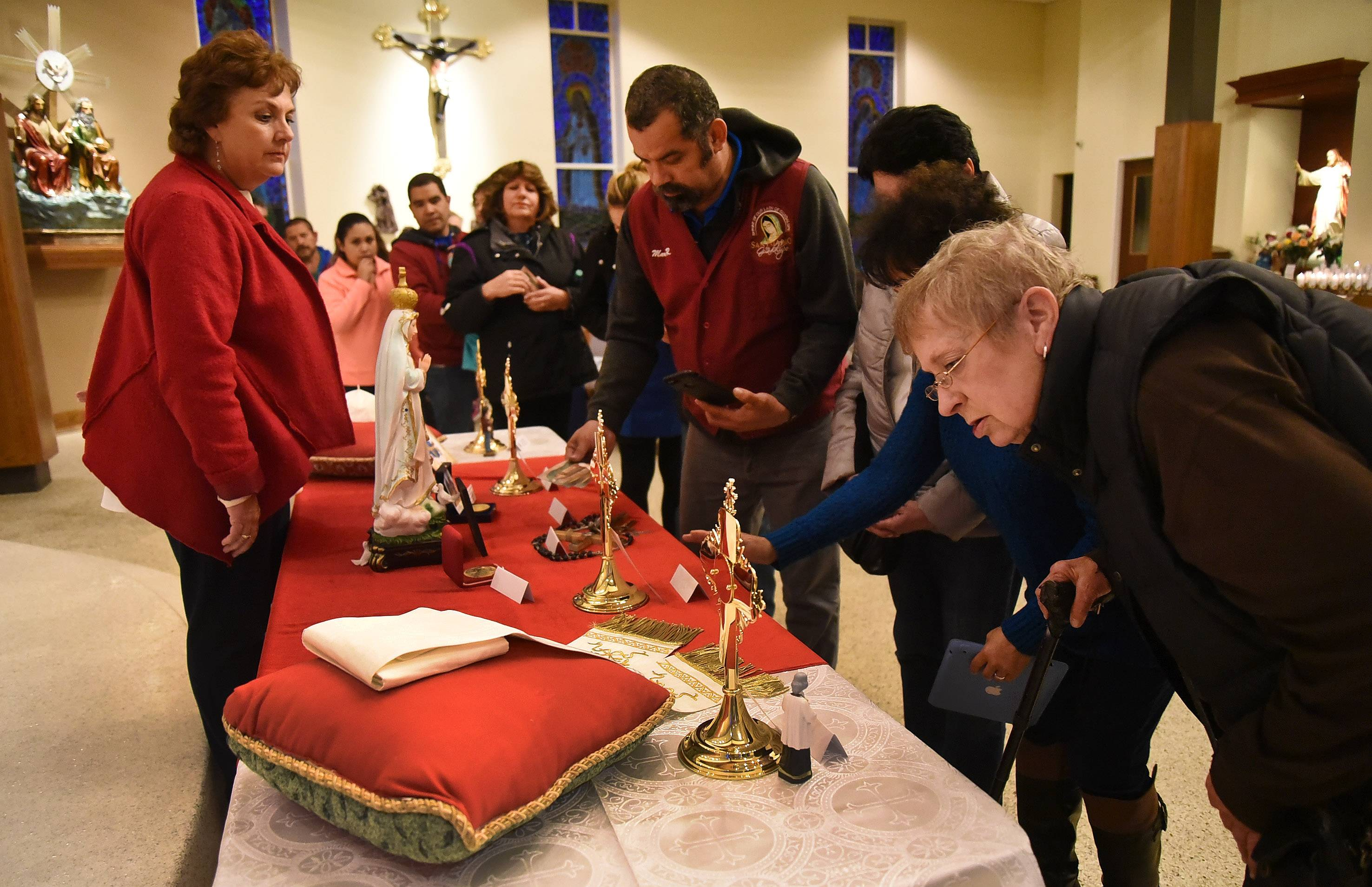 Eileen Wright of Des Plaines, right, gets a closer look at some of the relics.