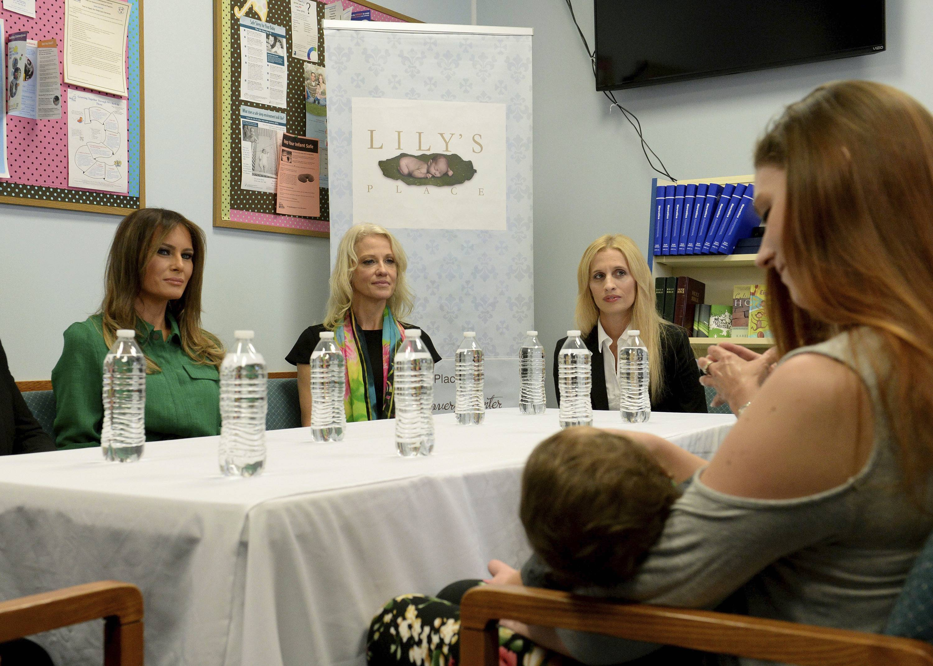 First lady Melania Trump, left, participates in a roundtable discussion Tuesday at Lily's Place in Huntington, West Virginia. Lily's Place is the nation's first nonprofit infant addiction recovery center.