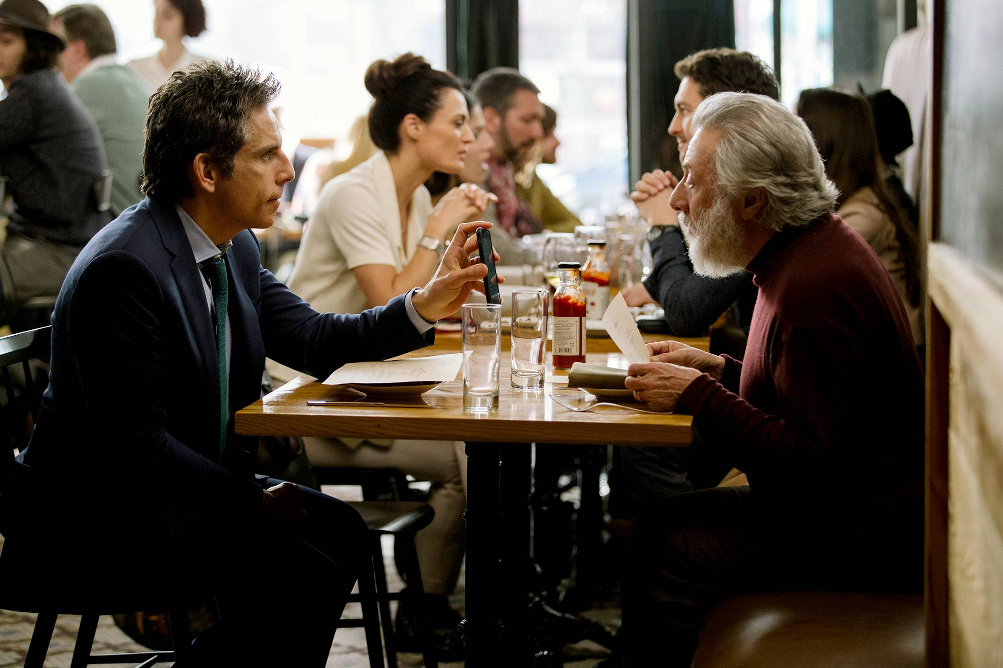 "Harold (Dustin Hoffman), right, meets up with his son (Ben Stiller) in ""The Meyerowitz Stories."""