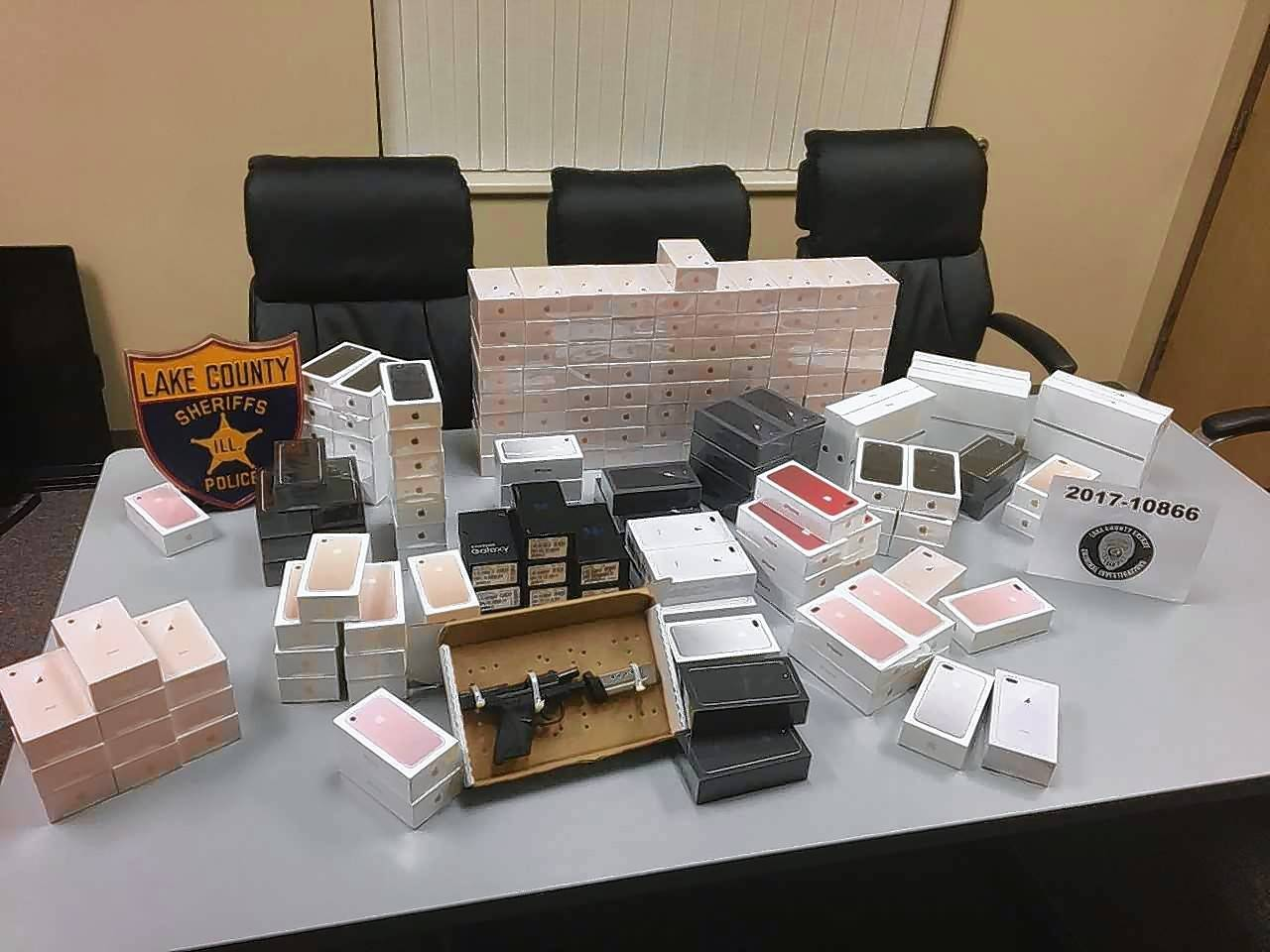 Authorities say these items stolen from the AT&T Store in Deer Park during an armed robbery Wednesday were recovered later from two men suspected in the holdup.