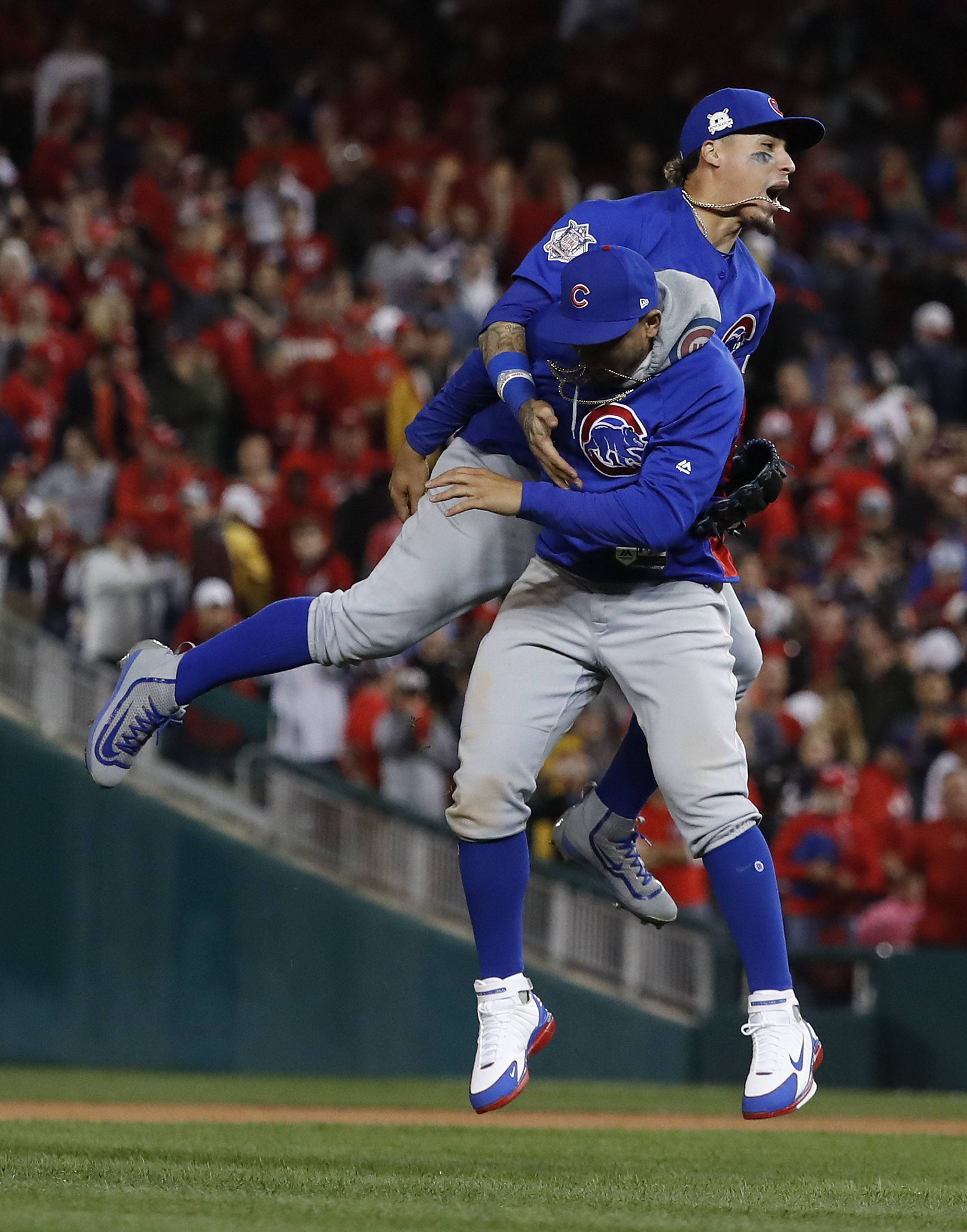 Cubs Javier Baez and Jon Jay celebrate after beating the Washington Nationals 9-8 to to win baseball's National League Division Series, at Nationals Park, early Friday, in Washington. The Cubs' championship window remains wide open as they head to the NLCS for the third straight year.