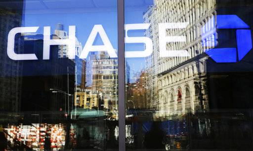 This Monday, Jan. 11, 2016, photo shows a Chase bank branch in New York. JPMorgan Chase & Co. reports earnings Thursday, Oct. 12, 2017. (AP Photo/Mark Lennihan)