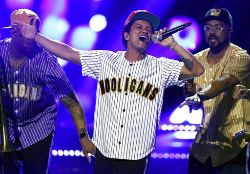 "FILE - In this Sunday, June 25, 2017, file photo, Bruno Mars performs ""Perm"" at the BET Awards at the Microsoft Theater in Los Angeles. Mars is the top nominee with eight nods at the American Music Awards, while The Chainsmokers, Drake, Kendrick Lamar, Ed Sheeran and The Weeknd all earned five nominations each. The show will broadcast live from the Microsoft Theater in Los Angeles on Nov. 19 at 8:00 p.m. Eastern on ABC. (Photo by Matt Sayles/Invision/AP, File)"