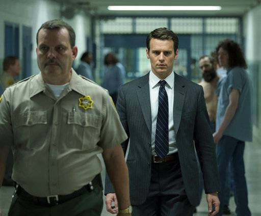 "This image released by Netflix shows Jonathan Groff in a scene from the 10-episode series, ""Mindhunter,"" streaming on Netflix starting Friday. (Patrick Harbron/Netflix via AP)"
