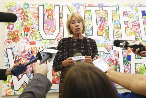 Education secretary Betsy DeVos addresses reporters during her visit to McMinnville High School in McMinnville, Ore., Wednesday, Oct. 11, 2017. (Rockne Roll/News Register via AP)