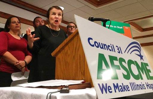 American Federation of State, County and Municipal Employees (AFSCME) Council 31 Executive Director Roberta Lynch speaks at a news conference Thursday, Oct. 12, 2017, in Springfield, Ill. The union representing corrections officers says inmate attacks on state employees have increased 51 percent since 2015. AFSCME says the Illinois Department of Corrections is reclassifying violent inmates to lower security levels to save money. Those inmates are transferred to medium-security prisons which are less costly to run. (AP Photo/John O'Connor)