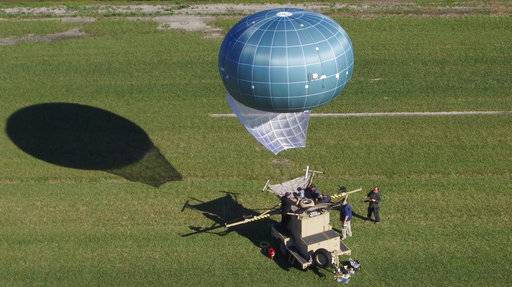 In this undated aerial photo provided by Drone Aviation Corp. shows a tethered balloon, called Winch Aerostat Small Platform, or WASP. The U.S. Border Patrol is considering another type of surveillance balloon to spot illegal activity. It's part of an effort to see if more eyes in the sky translate to fewer illegal border crossings. (Drone Aviation Corp. via AP)