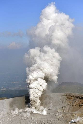 Volcanic smoke rises from the Shinmoedake volcano after its eruption in the border of Kagoshima and Miyazaki prefectures, southwestern Japan, Thursday, Oct. 12, 2017. The volcano erupted Thursday for the first time in six years and spread ash in nearby cities and towns. (Tomoaki Ito/Kyodo News via AP)