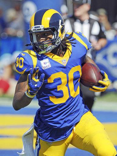 FILE - In this Oct. 8, 2017, file photo, Los Angeles Rams running back (30) Todd Gurley II gains yards on a run in the first quarter of an NFL game against the Seattle Seahawks, in Los Angeles. The Jaguars (3-2) hope to end all those futility streaks Sunday when they host the Rams (3-2) in a matchup of two of the NFL's most surprising teams in 2017. (AP Photo/John Cordes, File)