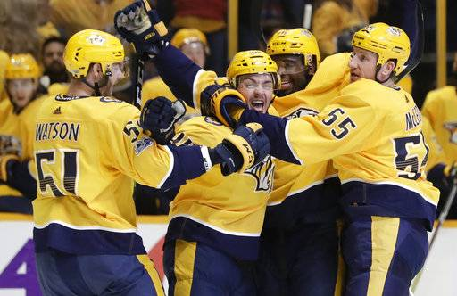 Nashville Predators defenseman Samuel Girard, second from left, celebrates with Austin Watson (51), P.K. Subban (76) and Cody McLeod (55) after scoring a goal against the Dallas Stars in the second period of an NHL hockey game Thursday, Oct. 12, 2017, in Nashville, Tenn. (AP Photo/Mark Humphrey)