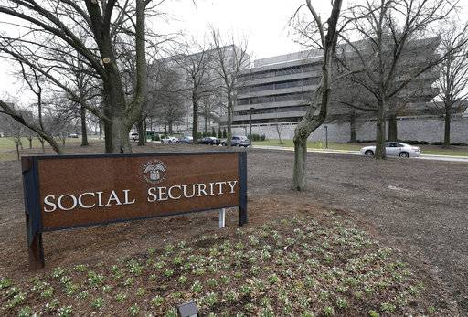 FILE - In this Jan. 11, 2013 file photo, the Social Security Administration's main campus is seen in Woodlawn, Md. Millions of Social Security recipients and other retirees can expect another small increase in benefits in 2018. Preliminary figures suggest an increase of around 2 percent. That would mean an extra $25 a month for the average beneficiary. The Social Security Administration is scheduled to announce the cost-of-living adjustment on Oct. 13, 2017.