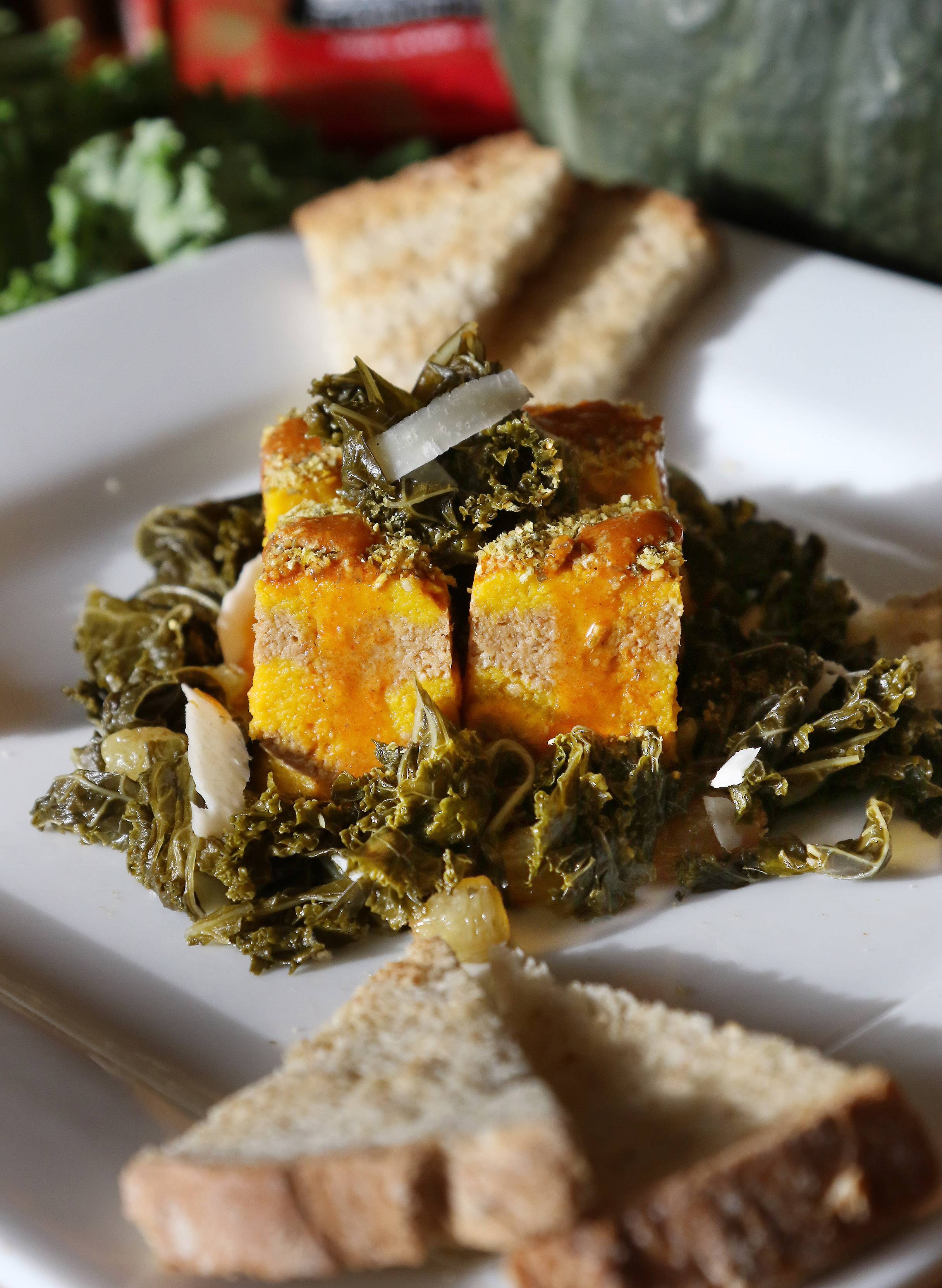 Gilbert R. Boucher II/gboucher@dailyherald.comTimbale Of Roasted Squash And Sardine Mousseline With Quick Pickled Kale made by Cook of the Week Challenge contestant Joe Wachter of Lake Zurich.