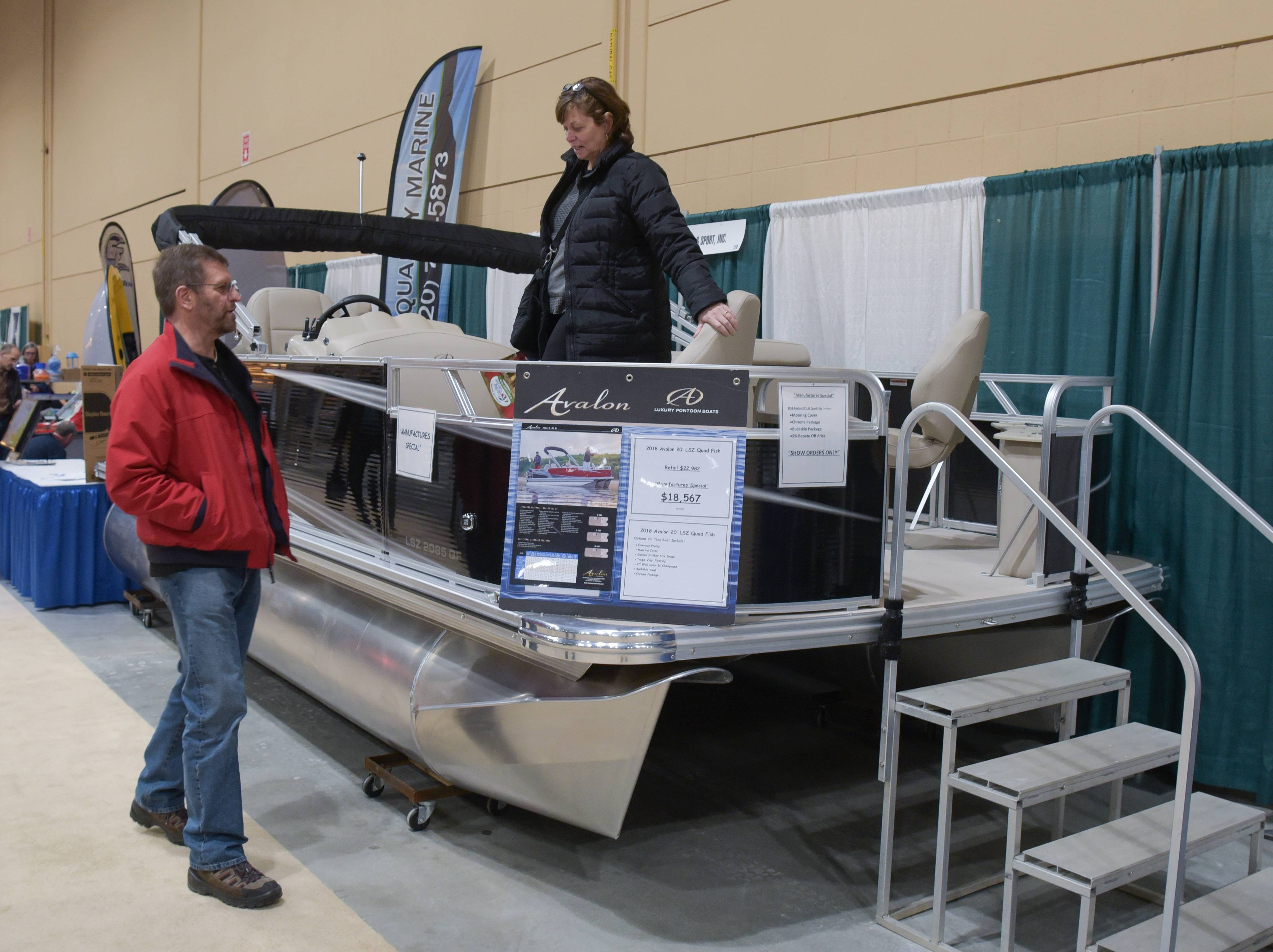 Grant and Linda Vankerk of Downers Grove check out a pontoon boat Sunday at the annual Schaumburg Lake Home & Cabin Show at the Schaumburg Convention Center.