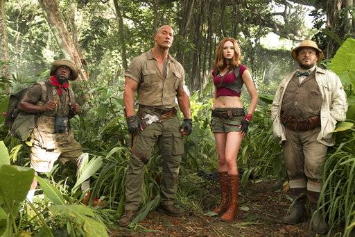 "FILE - This file image released by Sony Pictures shows Kevin Hart, from left, Dwayne Johnson, Karen Gillan and Jack Black in ""Jumanji: Welcome to the Jungle."" Columbia Pictures says Sunday, Jan. 7, 2018, that the Johnson-led ""Jumanji� is estimated to have earned an additional $36 million, bringing its total to $244.4 million. (Frank Masi/Sony Pictures via AP, File)"