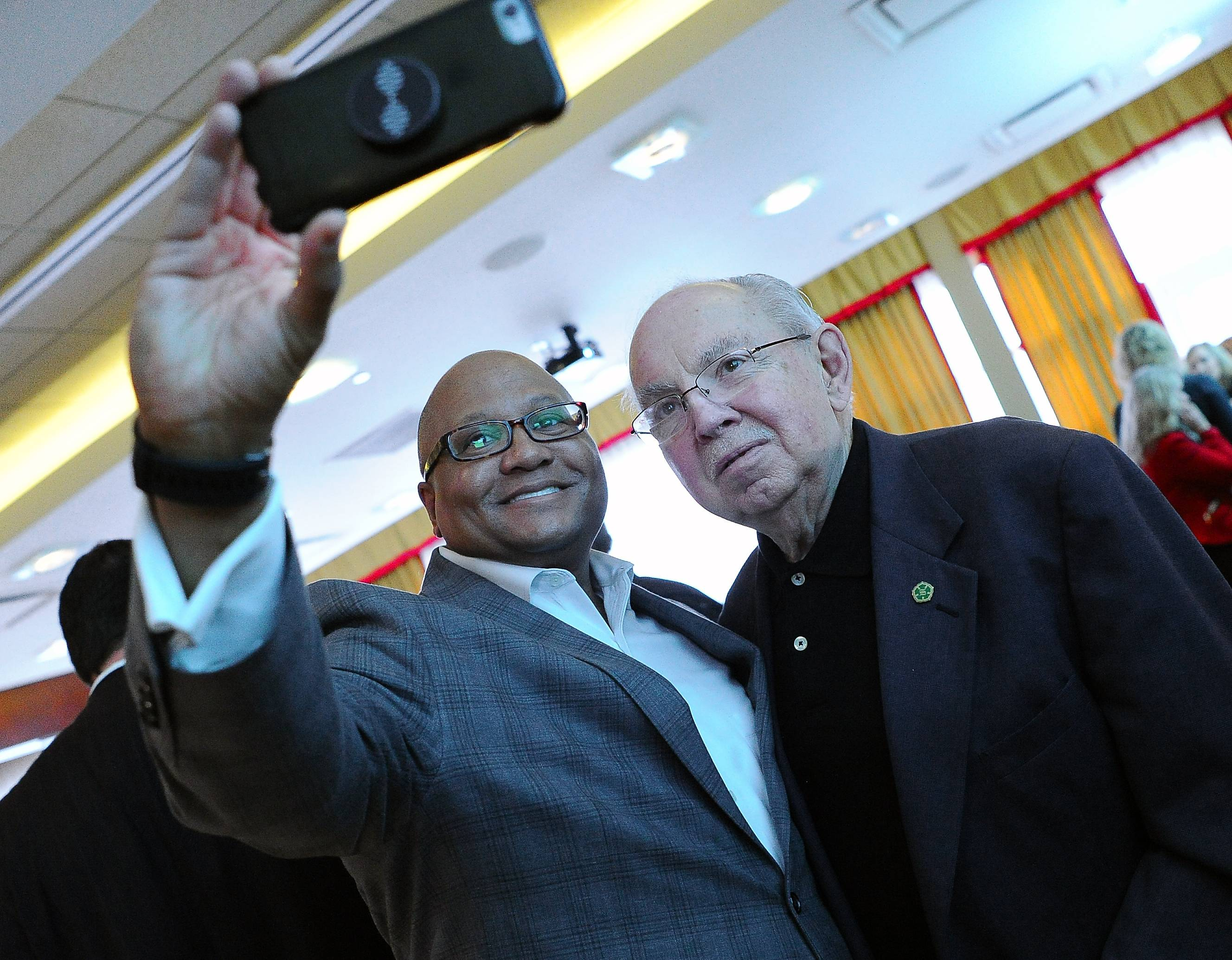 Schaumburg Mayor Al Larson takes a photo with Donovan Pepper, national director of local government relations for Walgreens, at the annual state of the village address before the Schaumburg Business Association on Tuesday.