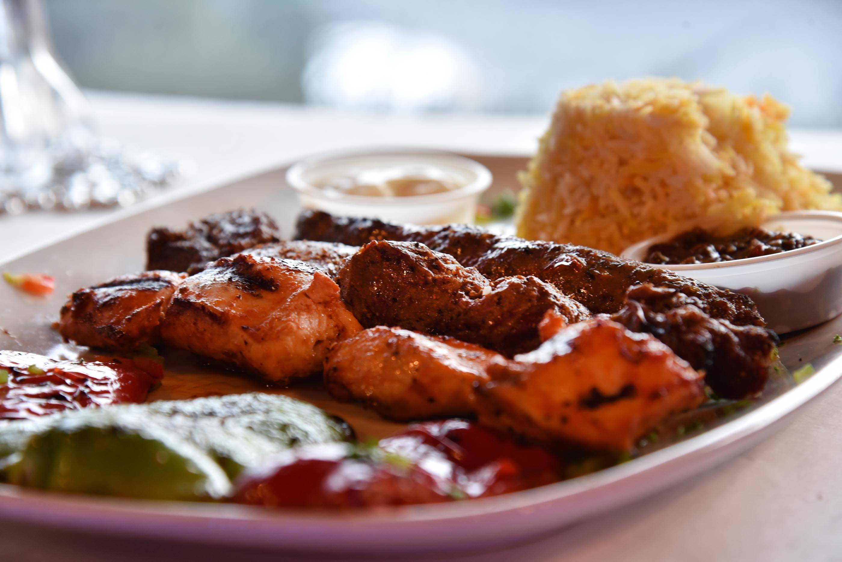 The combo plate lets diners try multiple meats at Eden on the River in St. Charles.