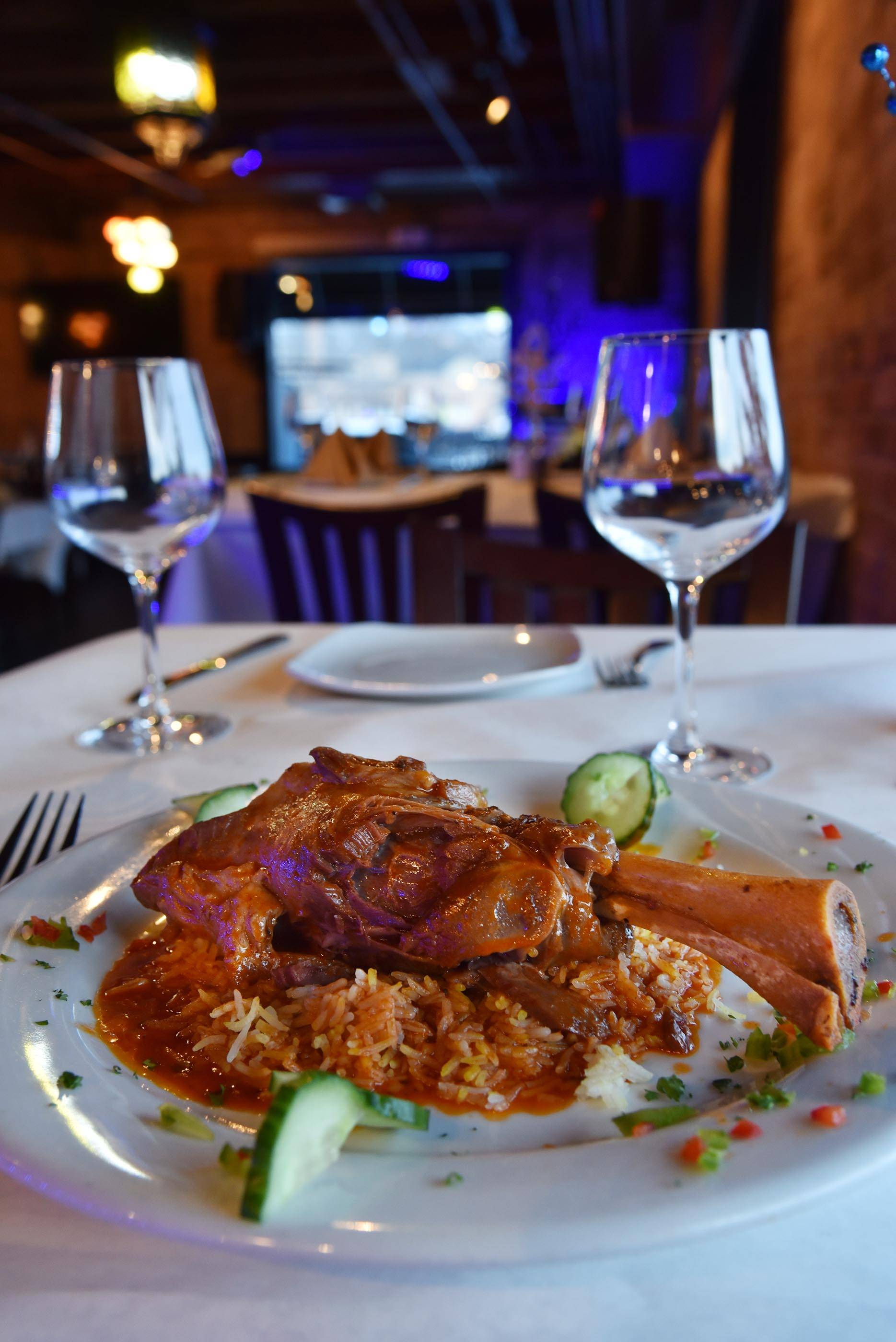 The lamb shank is served on a bed of basmati rice at Eden on the River in St. Charles.