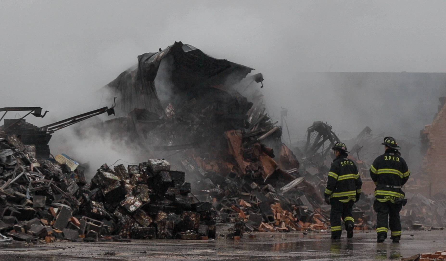 Firefighters spent much of the day Thursday on the scene of a massive fire that broke out late Wednesday night at Maine Scrap Metal on Rand Road in Des Plaines.