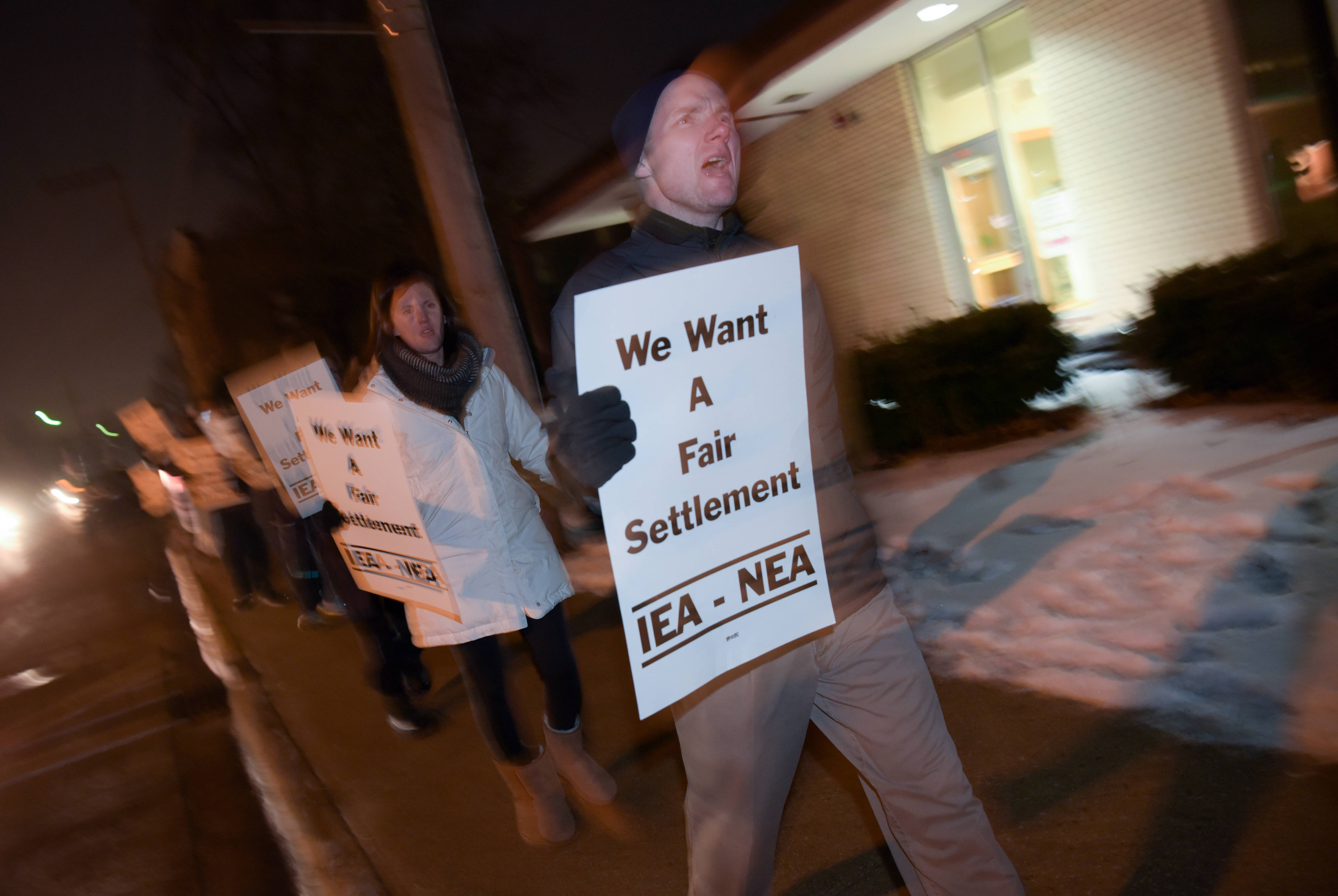 West Chicago High School teachers picketed outside the district office Tuesday. On Wednesday the teachers union declared an impasse in contract talks.