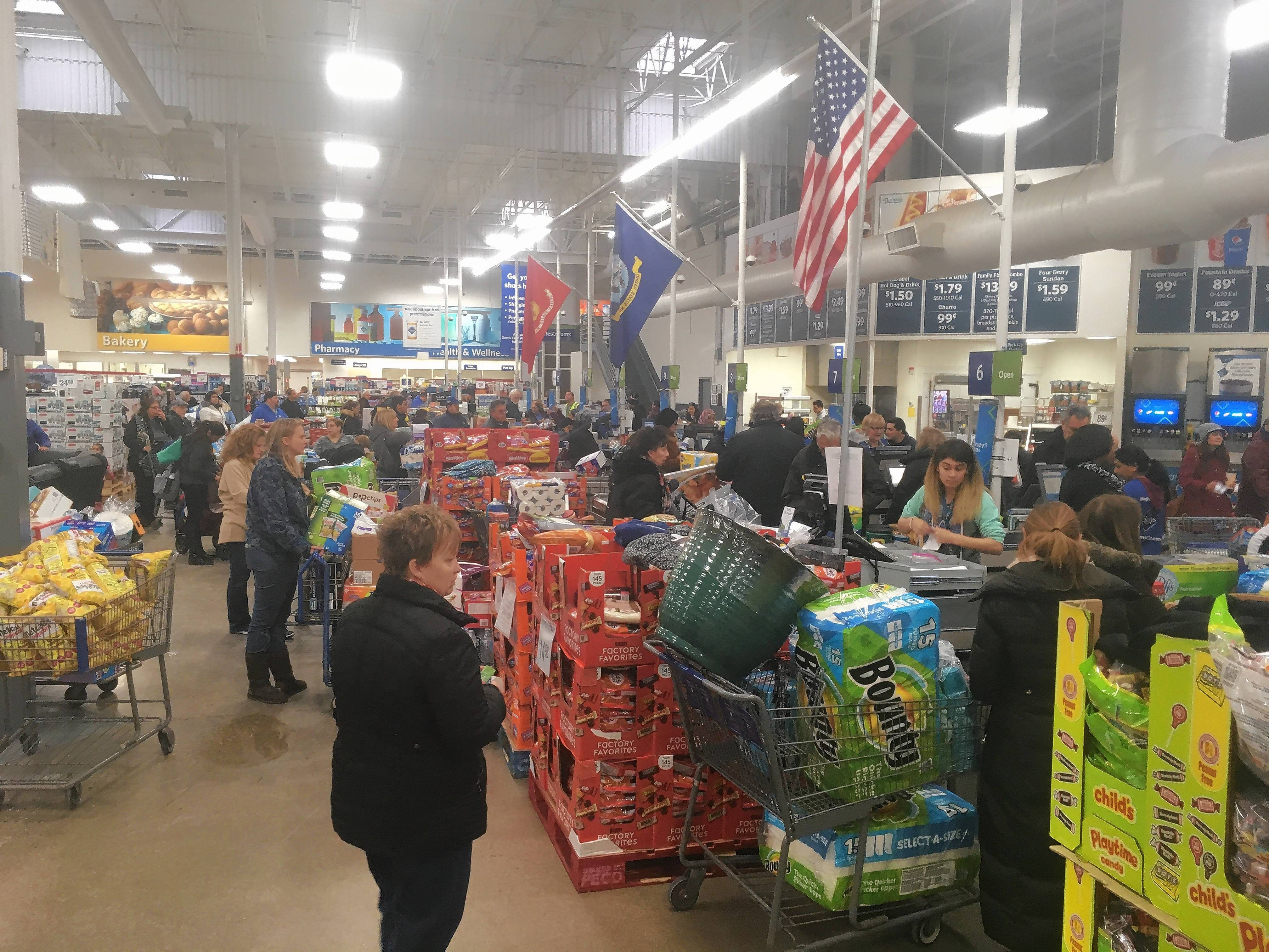 Shoppers flocked to the Sam's Club in Wheeling to get discounts Friday, a day after the company announced it was closing the store and five others in the suburbs.